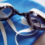 photo of swimming goggles and cap