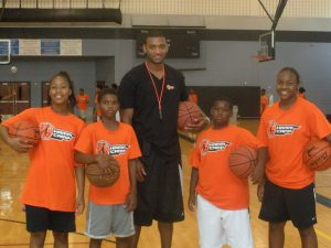 Pro basketball player Lawrence Hamm at his sports camp for kids